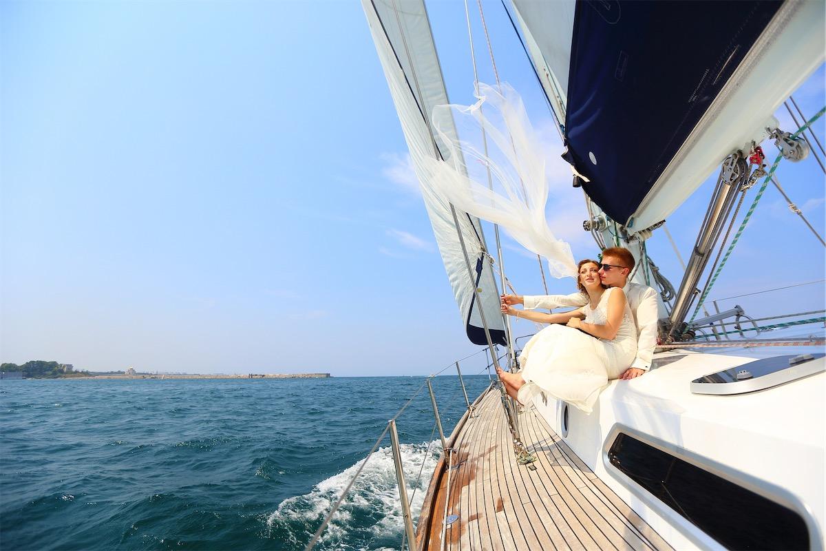 Couple having their wedding on a yacht