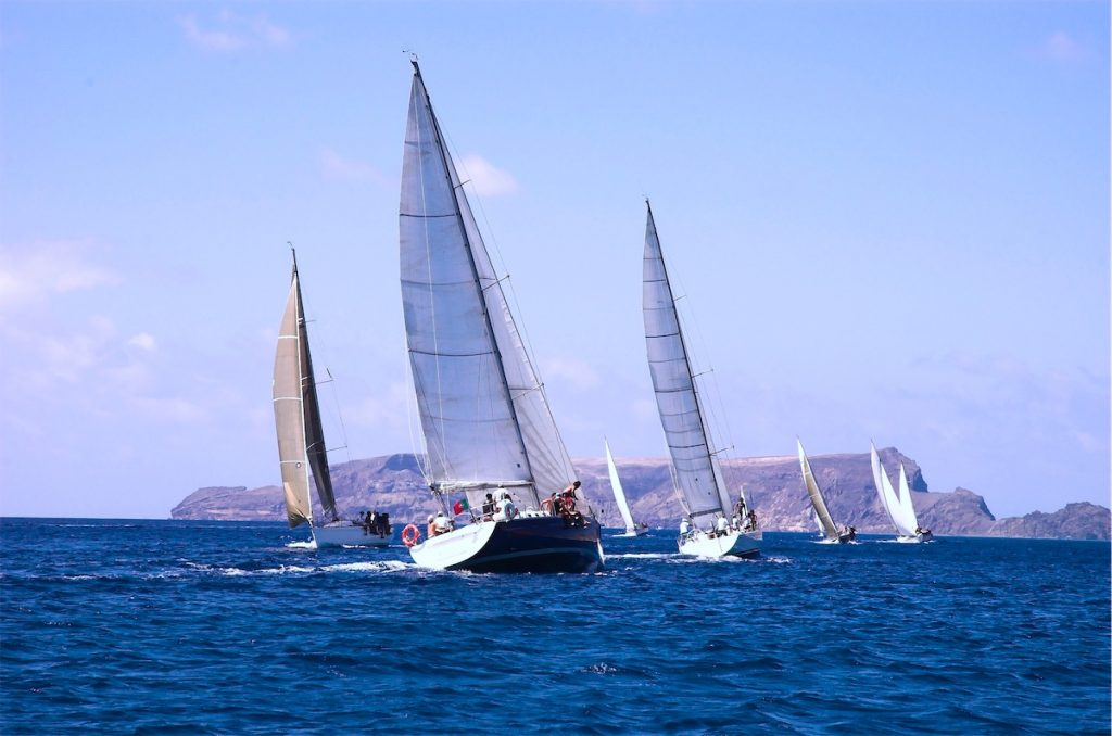 3 sailing yachts sailing across the sea